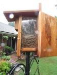 """Bluebird house with """"view"""" door open."""
