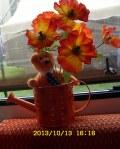 Ty bear, watering pot, artificiial flowers