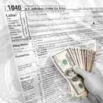 Income Tax form with dollars