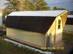 Snow on storage shed