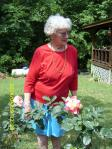Dottie with her rose bushes
