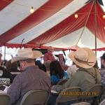 Cowboys listening to preacher