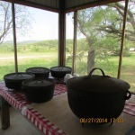 Iron Dutch ovens with evening meal