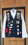 Denim vest with badges (front)