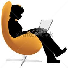 Sitting in chair with laptop computer