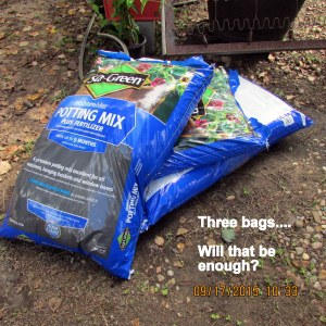 Three bags of potting soil