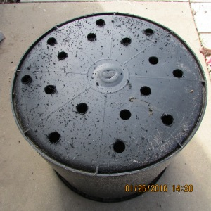Hole in large black planter