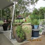Two rain barrels at corner of patio