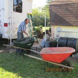 One wheelbarrow to haul bags; one wheelbarrow to mix concrete