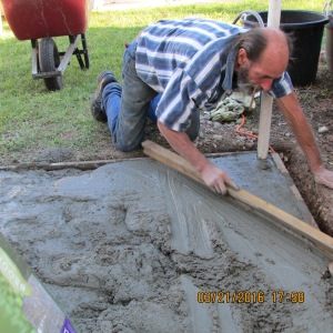 David smoothing the concrete