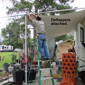 Deflappers on awning