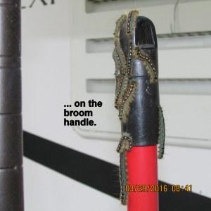 On the broom handle
