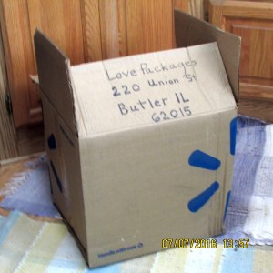 Box is labeled to Love Packages
