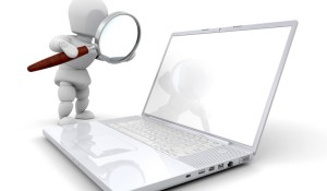 Clipart Illustration of a White Character Using A Magnifying Glass To Inspect A Laptop, Over White