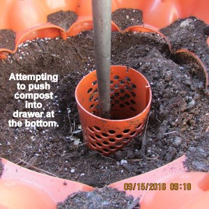 Pushing compost out the bottom