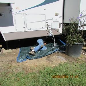 Roger under trailer