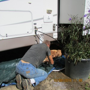 Pulling wet insulation from underneath trailer
