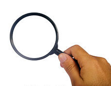 magnifying-glass-with-human-hand