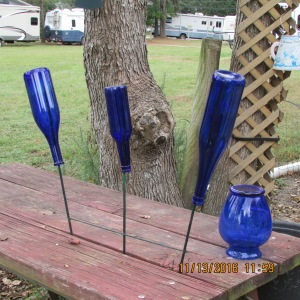 Blue bottles on picnic table