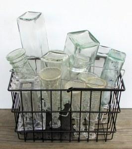 Square bottles in square basket