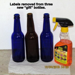 Labels removed from three bottles