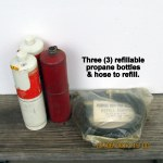 Three refillable propane bottles